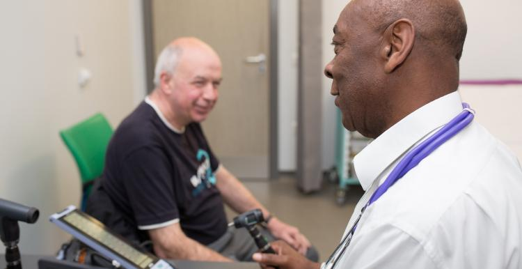 GP consulting with a patient