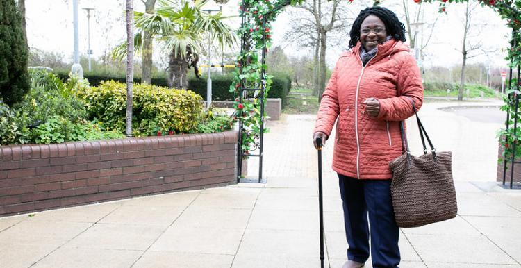 Photo of woman with walking stick