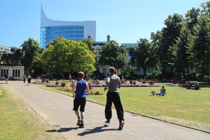 Photo of people running in Forbury Gardens Reading