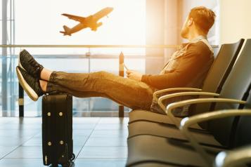 Photo of traveller at airport by Unsplash