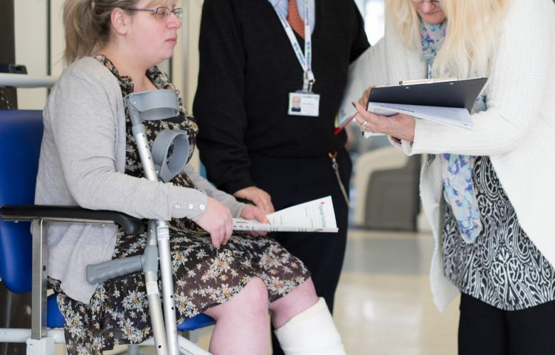 Photo of woman with injured leg in wheelchair